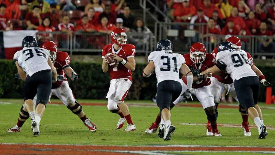 The University of Houston's quarterback Case Keenum center sets up for a pass against Rice University during the second quarter of college football game action at Robertson Stadium Thursday, Oct. 27, 2011, in Houston. Photo: James Nielsen, Chronicle / © 2011 Houston Chronicle