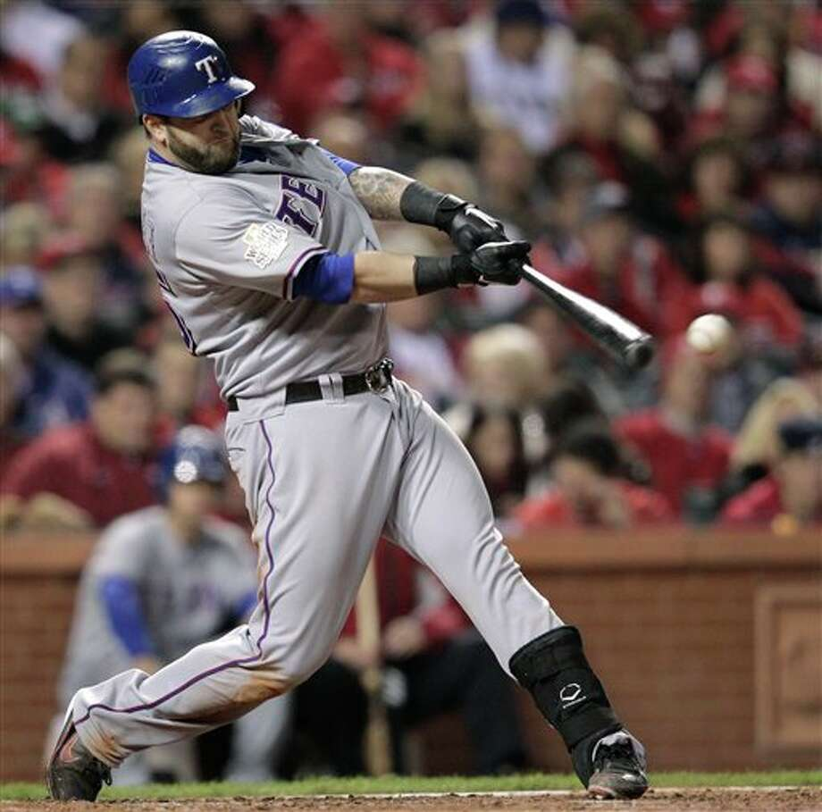 Texas Rangers' Mike Napoli gets a run-scoring hit during the fourth inning of Game 6 of baseball's World Series against the St. Louis Cardinals Thursday, Oct. 27, 2011, in St. Louis. (AP Photo/Charlie Riedel) Photo: Express-News