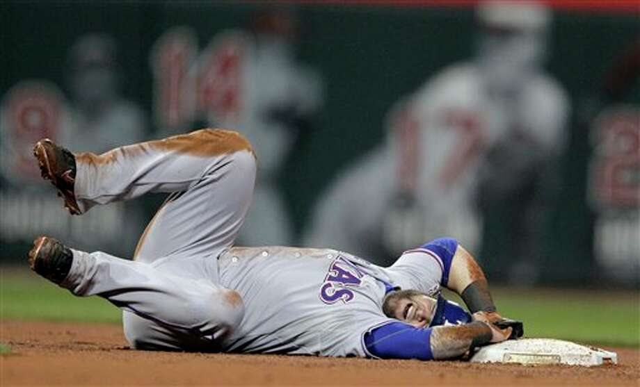 Texas Rangers' Mike Napoli reacts after hurting his ankle during the fourth inning of Game 6 of baseball's World Series against the St. Louis Cardinals Thursday, Oct. 27, 2011, in St. Louis.  (AP Photo/Charlie Riedel) Photo: Express-News