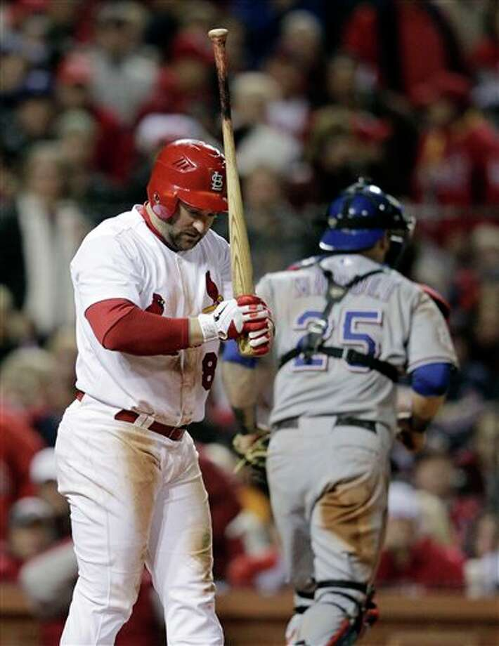 St. Louis Cardinals' Nick Punto reacts in front of Texas Rangers catcher Mike Napoli after striking out during the fourth inning of Game 6 of baseball's World Series Thursday, Oct. 27, 2011, in St. Louis. (AP Photo/Charlie Riedel) Photo: Express-News