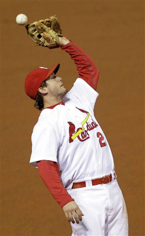 St. Louis Cardinals' David Freese can't catch a fly ball off the bat of Texas Rangers' Josh Hamilton during the fifth inning of Game 6 of baseball's World Series Thursday, Oct. 27, 2011, in St. Louis. (AP Photo/Paul Sancya) Photo: Express-News
