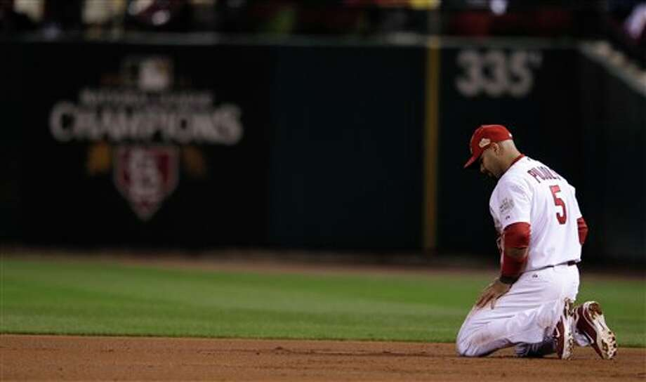 St. Louis Cardinals' Albert Pujols reacts after missing a ball hit by Texas Rangers' Josh Hamilton during the sixth inning of Game 6 of baseball's World Series Thursday, Oct. 27, 2011, in St. Louis. (AP Photo/Matt Slocum) Photo: Express-News