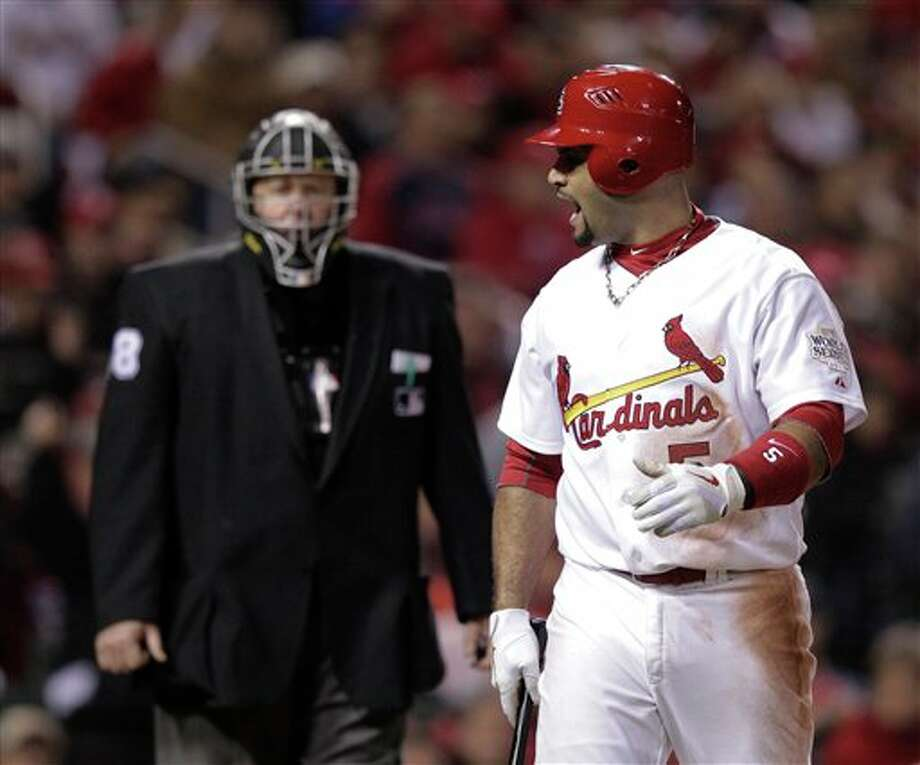 St. Louis Cardinals' Albert Pujols yells at home plate umpire Gary Cederstrom after striking out during the sixth inning of Game 6 of baseball's World Series against the Texas Rangers Thursday, Oct. 27, 2011, in St. Louis. (AP Photo/Charlie Riedel) Photo: Express-News