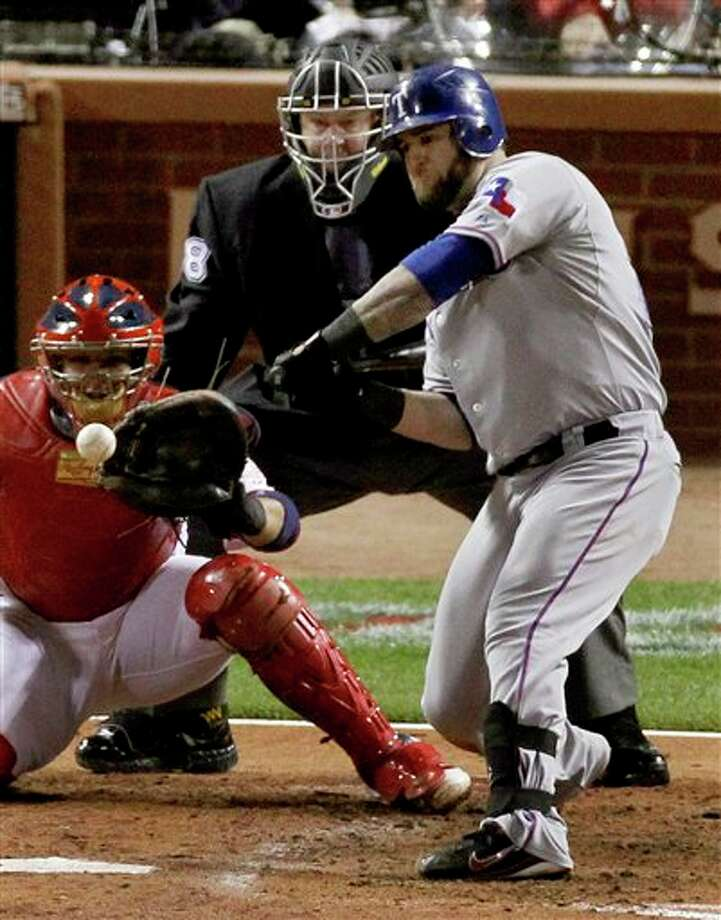 Texas Rangers' Mike Napoli hits a RBI single off a pitch by St. Louis Cardinals' Fernando Salas during the fourth inning of Game 6 of baseball's World Series Thursday, Oct. 27, 2011, in St. Louis. (AP Photo/Jeff Roberson) Photo: Express-News