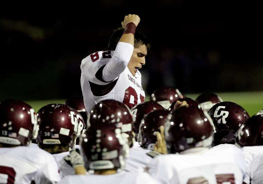 10/27/11: Senior, Dennis Dehkordi #82 of the Cinco Ranch Cougars fires up his teammates before they played against the Mortan Ranch Mavericks in a district high school football game at Rhodes Stadium in Katy, Texas. Thomas B. Shea Photo: For The Chronicle: Thomas B. She