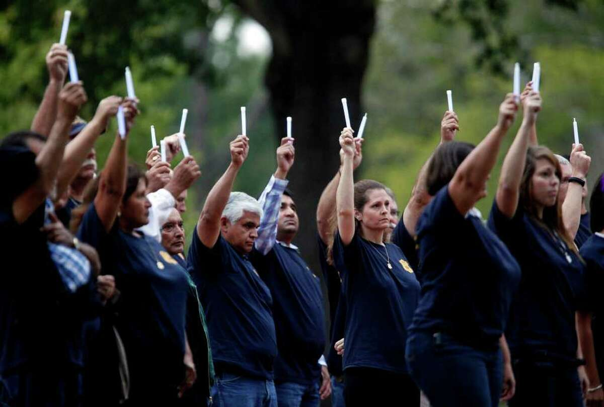 Supporters of the family of slain San Antonio Police Officer Hector Garza, including retired and current SAPD officers, hold up glow sticks at 6 p.m. on Thursday, Oct. 27, 2011, the scheduled time for the execution of Frank Garcia at the Huntsville Unit of the Texas State Penitentiary. The execution of Garcia, who murdered Garza on March 29, 2001, occurred almost an hour later because of an 11-hour appeal to the U.S. Supreme Court.