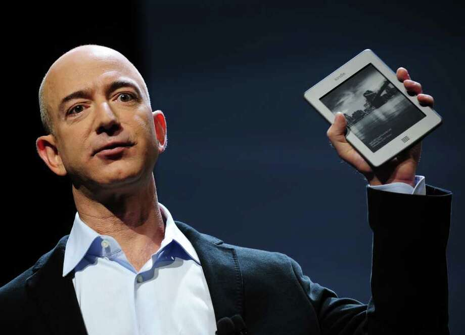 Amazon CEO Jeff Bezos introduces the new Kindle Touch in New York, September 28, 2011. Bezos introduced a line of four new Kindle products, the Kindle Fire tablet, the Kindle Touch 3G, the Kindle Touch and a new lighter and smaller Kindle. AFP PHOTO/Emmanuel Dunand Photo: EMMANUEL DUNAND, AFP/Getty Images / 2011 AFP