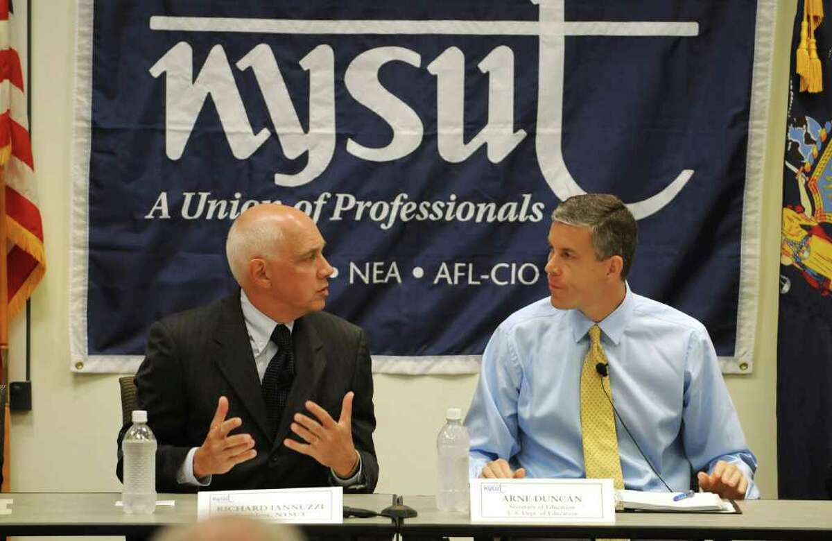 From left, Richard C. Iannuzzi, President, NYSUT, and Arne Duncan, U.S. Education Secretary, head a round table with teams of teachers about reform and pilot program on teacher evaluations, at NYSUT headquarters in Latham, NY on August 30, 2010. (Lori Van Buren / Times Union)