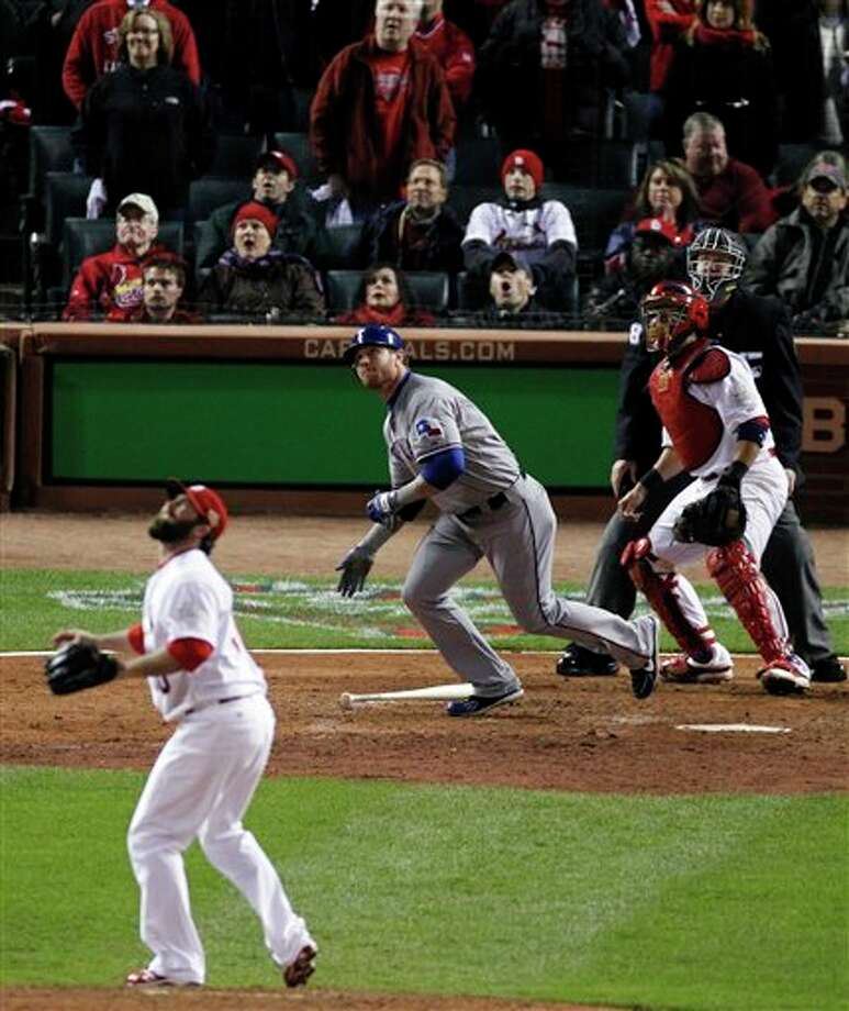 Texas Rangers' Josh Hamilton watches his two-run home run off a pitch by St. Louis Cardinals' Jason Motte during the tenth inning of Game 6 of baseball's World Series Thursday, Oct. 27, 2011, in St. Louis. (AP Photo/Jeff Roberson) Photo: Associated Press