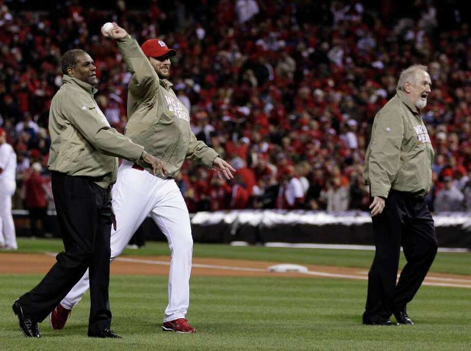 Former St. Louis Cardinals' Bob Gibson, Adam Wainwright and Bruce Sutter throw out the ceremonial first pitch Game 1 of baseball's World Series between the St. Louis Cardinals and the Texas Rangers Wednesday, Oct. 19, 2011, in St. Louis. Photo: AP