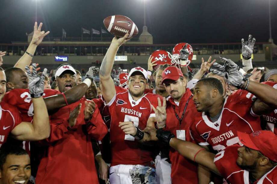 Oct. 27: No. 18 UH 73, Rice 34University of Houston QB Case Keenum, center, among team celebrating  73- 34 win over Rice University at Robertson Stadium Thursday, Oct. 27, 2011, in Houston. Photo: Melissa Phillip, Houston Chronicle / © 2011 Houston Chronicle