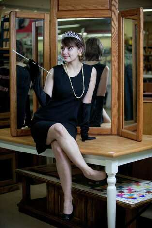 "Bailey Davidson models an ""Audrey Hepburn"" costume.Tiara - $6.99Long black gloves - $4.99Old fashion cigarette holder - $1.99Pearls - $2.99Little black dress - models ownAbout $17 Photo: JOSHUA TRUJILLO / SEATTLEPI.COM"