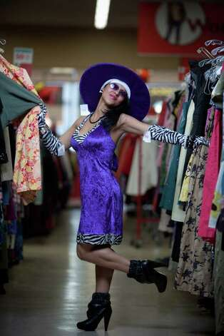 "Anya Lynch models a ""disco queen"" costume.Purple/zebra disco outfit with hat - used/donated costume $9.99Purple glasses - $1.99Disco stick - $6.99About $19 Photo: JOSHUA TRUJILLO / SEATTLEPI.COM"