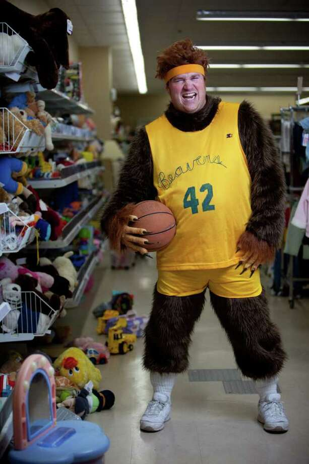 """Ruste Ryan models a """"Teen Wolf"""" costume -furry jumpsuit, jersey and sweatband: used/donated costume $14.99 -brown wig: new item $4.99  about $20  Photographed at the Crown Hill Value Village on Thursday, October 27, 2011. Photo: JOSHUA TRUJILLO / SEATTLEPI.COM"""