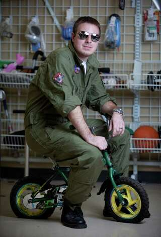 "Tyler Nipper models a ""Maverick"" costume.Jumpsuit with patches sewn on - $12.99Aviator glasses - $1.99Black shoes - models ownAbout $15 Photo: JOSHUA TRUJILLO / SEATTLEPI.COM"
