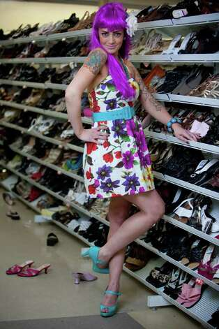 "Heidi Cecil models a ""Katy Perry"" costume.Floral halter dress - $9.99Purple wig - $6.99Bright colored shoes - $7.99Colorful accessories -models ownAbout $25 Photo: JOSHUA TRUJILLO / SEATTLEPI.COM"