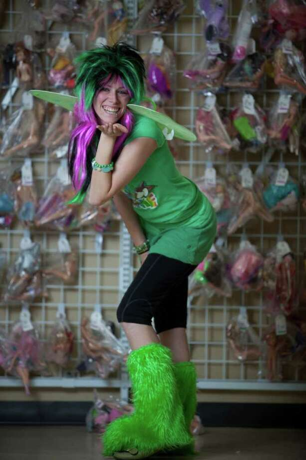 """Jennifer Smith models a """"Punk Fairy"""" costume -wings: used/donated costume $2.99 -furry boot covers: new item $5.99 -leggings/skirt: models own -t-shirt: used item: $2.99 -punk rock wig: new item $5.99  about $18  Photographed at the Crown Hill Value Village on Thursday, October 27, 2011. Photo: JOSHUA TRUJILLO / SEATTLEPI.COM"""