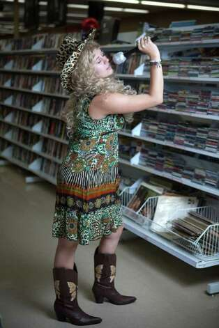 "Ashley Edwards models a ""Taylor Swift"" costume.Cowboy boots - $9.99Microphone - $1.99Curly wig - $6.99Sundress - models ownAbout $19 Photo: JOSHUA TRUJILLO / SEATTLEPI.COM"