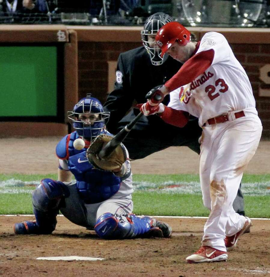 St. Louis Cardinals' David Freese hits a solo home run off a pitch by Texas Rangers' Mark Lowe. Photo: Jeff Roberson, Associated Press / AP