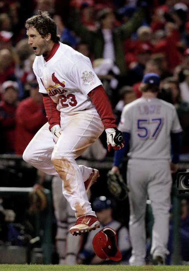 Game 6: Cardinals 10, Rangers 9 Cardinals third baseman David Freese celebrates his walk-off home run during the 11th inning to force Game 7. Photo: Charlie Riedel, Associated Press / AP