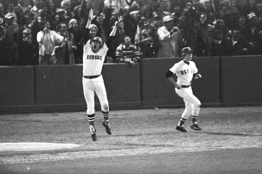 1975: Red Sox 7, Reds 6 (12  innings)The image lives forever, Carlton Fisk  waving the ball fair as it traveled down the left field line to win a game in  which the Red Sox both blew a three-run lead and erased a three-run  deficit.Game 7:  The Big Red Machine proved too powerful for the Red Sox, out for their first  World Series crown in 57 years. Cincinnati erased a 3-0 deficit to win the game and the  series 4-3, but with Fisk's homer the memorable moment, they say in Boston that the Sox won that series 3 games to 4. Photo: HARRY CABLUCK, AP / AP
