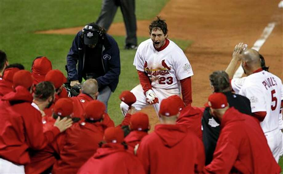 Teammates celebrate with St. Louis Cardinals' David Freese after Freese hit a walk-off home run during the 11th inning of Game 6 of baseball's World Series against the Texas Rangers Thursday, Oct. 27, 2011, in St. Louis. The Cardinals won the game 10-9 to tie the series 3-3. (AP Photo/Eric Gay) Photo: Associated Press