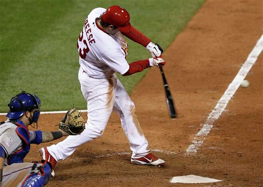 St. Louis Cardinals' David Freese hits a walk-off home run during the 11th inning of Game 6 of baseball's World Series against the Texas Rangers Thursday, Oct. 27, 2011, in St. Louis. The Cardinals won the game 10-9 to tie the series 3-3. (AP Photo/Eric Gay) Photo: Associated Press