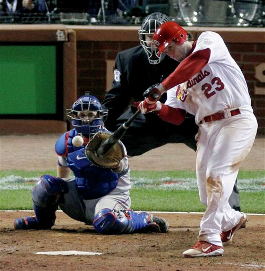 St. Louis Cardinals' David Freese hits a solo home run off a pitch by Texas Rangers' Mark Lowe in the 11th inning of Game 6 of baseball's World Series Thursday, Oct. 27, 2011, in St. Louis. The Cardinals won 10-9. (AP Photo/Jeff Roberson) Photo: Associated Press