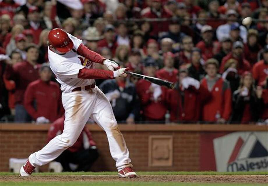 St. Louis Cardinals' David Freese hits a walk-off home run during the 11th inning of Game 6 of baseball's World Series against the Texas Rangers Thursday, Oct. 27, 2011, in St. Louis. The Cardinals won the game 10-9 to tie the series 3-3. (AP Photo/Charlie Riedel) Photo: Associated Press