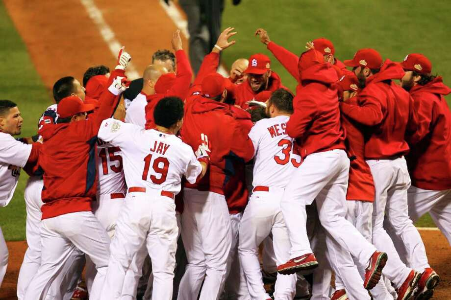 The St. Louis Cardinals celebrate after David Freese #23 hits a walk off solo home run in the 11th inning. Photo: Dilip Vishwanat / 2011 Getty Images