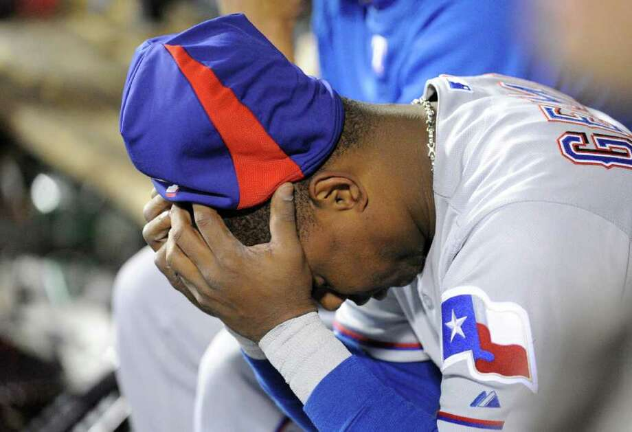 Texas Rangers' Esteban German was part of a heartbroken dugout as the St. Louis Cardinals twice rallied from two-run deficits in the ninth and 10th innings to forge ties in Game 6 of the World Series at Busch Stadium in St. Louis, Missouri, on Thursday, October 27, 2011. (Max Faulkner/Fort Worth Star-Telegram/MCT) Photo: Max Faulkner / Fort Worth Star-Telegram