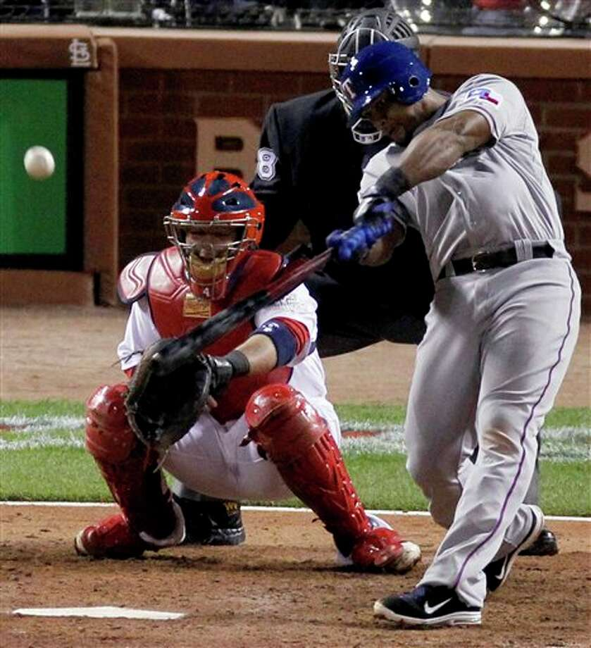 Texas Rangers' Adrian Beltre hits a solo home run during the seventh inning of Game 6 of baseball's World Series against the St. Louis Cardinals Thursday, Oct. 27, 2011, in St. Louis. (AP Photo/Jeff Roberson) Photo: Associated Press