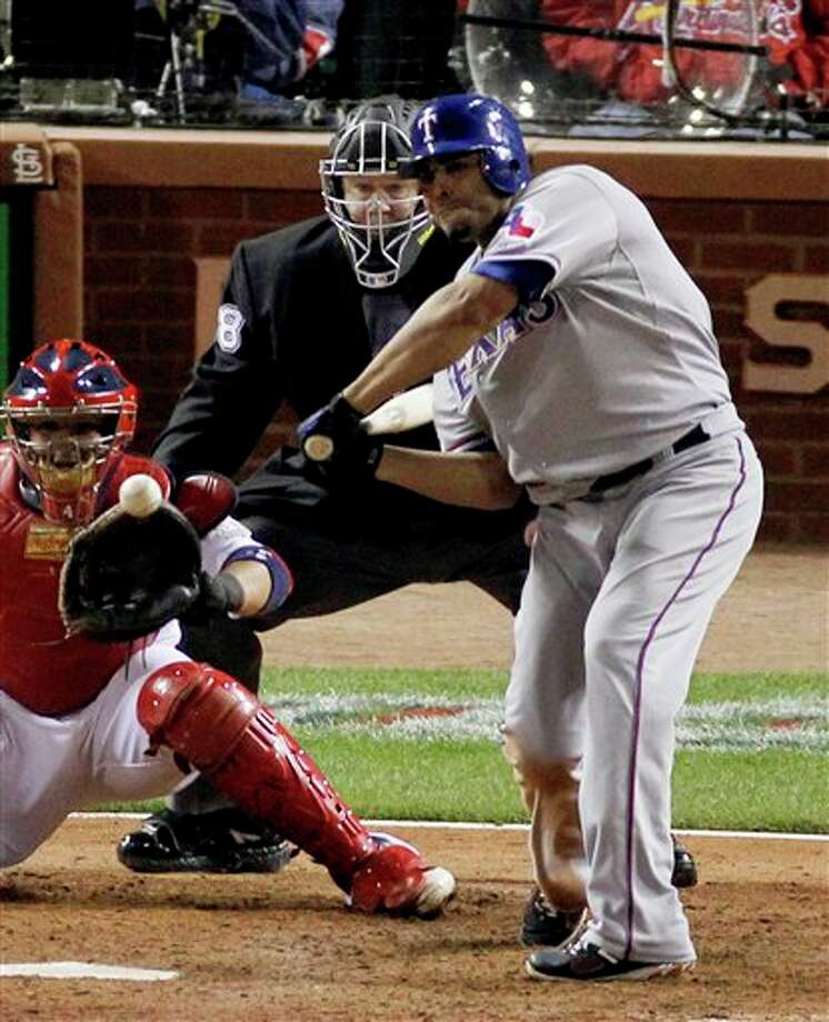 Texas Rangers' Nelson Cruz hits a solo home run off a pitch by St. Louis Cardinals' Lance Lynn during the seventh inning of Game 6 of baseball's World Series Thursday, Oct. 27, 2011, in St. Louis. (AP Photo/Jeff Roberson) Photo: Associated Press