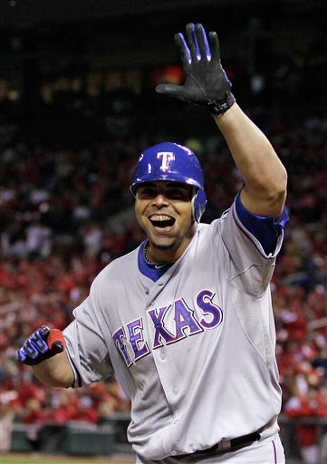 Texas Rangers' Nelson Cruz reacts after hitting a home run during the seventh inning of Game 6 of baseball's World Series against the St. Louis Cardinals Thursday, Oct. 27, 2011, in St. Louis. (AP Photo/Matt Slocum) Photo: Associated Press