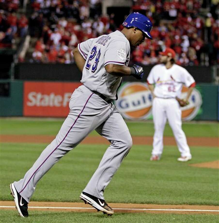 Texas Rangers' Adrian Beltre rounds the bases after hitting a home run off St. Louis Cardinals relief pitcher Lance Lynn (62) during the seventh inning of Game 6 of baseball's World Series Thursday, Oct. 27, 2011, in St. Louis. (AP Photo/Matt Slocum) Photo: Associated Press