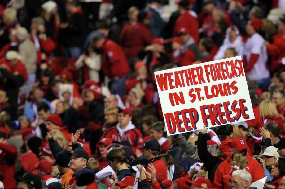 "A fan of the St. Louis Cardinals holds up a sign reading ""Weather Forecast in St. Louis Deep Freese"" after Game 6. Photo: Doug Pensinger, Getty / 2011 Getty Images"