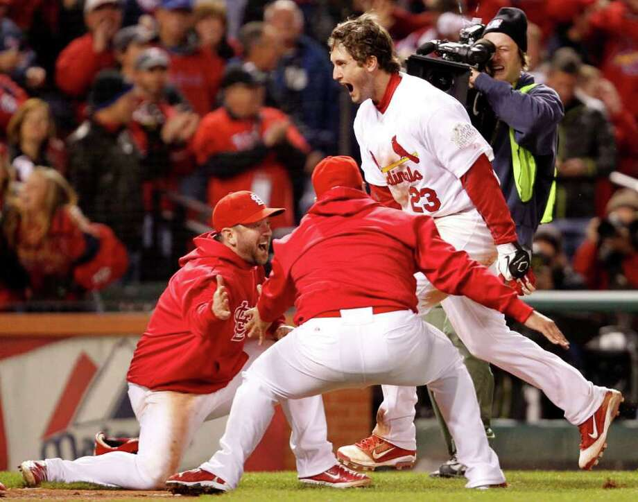 St. Louis Cardinals' David Freese (23) celebrates with teammates after he hit his game-winning solo home run. Photo: Ron Jenkins, McClatchy-Tribune News Service / Fort Worth Star-Telegram
