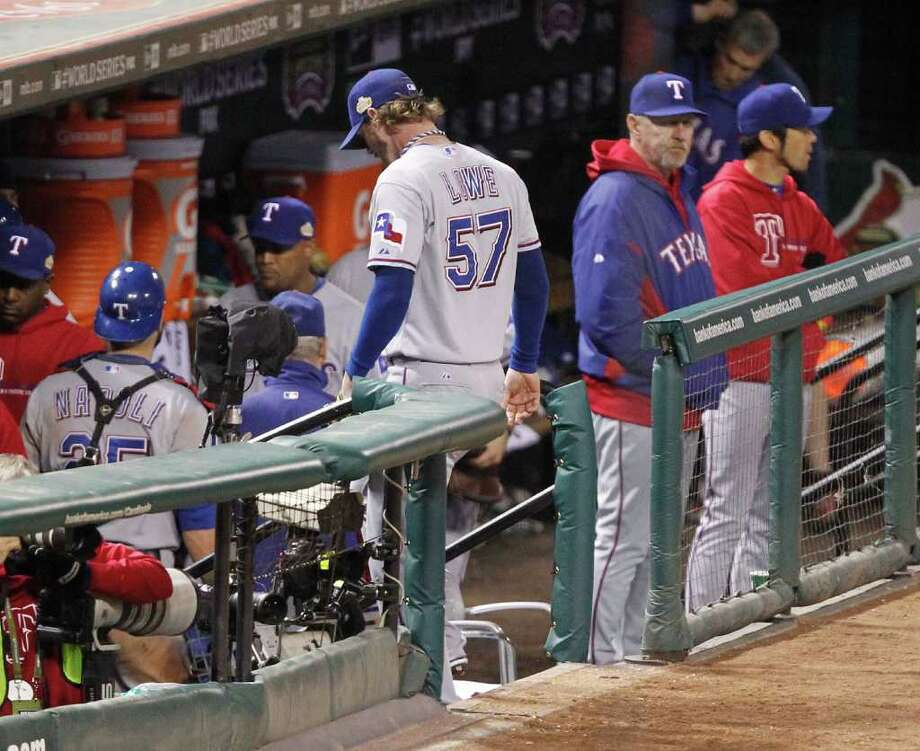 A dejected Texas Rangers dugout saw the St. Louis Cardinals twice rally from two-run deficits in the ninth and 10th innings before a David Freese home run won it, 10-9, for the Cardinals. Photo: Ron T. Ennis, McClatchy-Tribune News Service / Fort Worth Star-Telegram