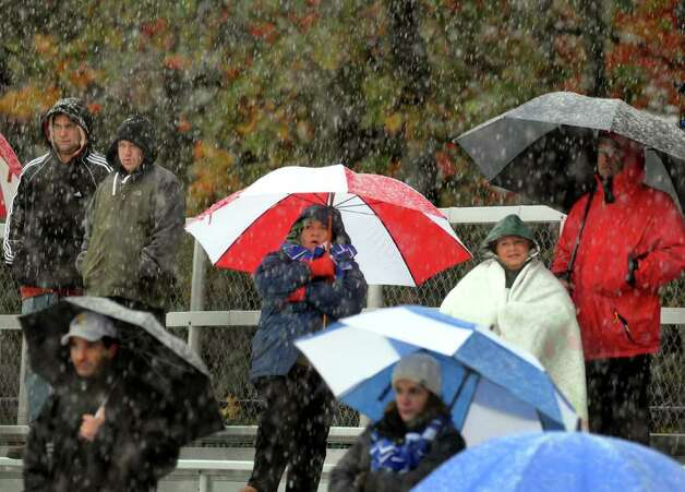 Dedicated fans brave the the season's first snowfall to watch Shaker play Schenectady in the Section II Class AA boys soccer game on Thursday, Oct. 27, 2011, at Schenectady High in Schenectady, N.Y. (Cindy Schultz / Times Union) Photo: Cindy Schultz, Albany Times Union