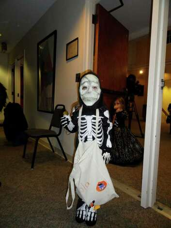 Kids dress up for the annual Halloween parade at Westport Town Hall. Photo: Todd Tracy / Stamford Advocate