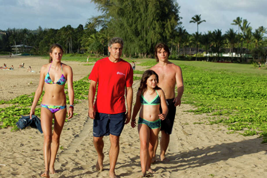 "(L-R) Shailene Woodley as Alexandra, George Clooney as Matt King, Amara Miller as Scottie and Nick Krause as Sid in ""The Descendants."""