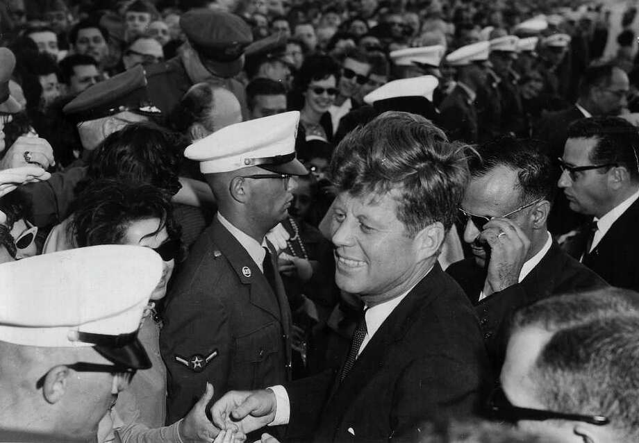"President John F. Kennedy visits Brooks AFB in  1963. A reader says Americans volunteered after Kennedy said ""Ask not what your country can do for you, ask what you can do for your country."" Similarly, she writes, wealthy Americans today can help with the financial crisis. Photo: Express-News File Photo / EXPRESS-NEWS ARCHIVES"