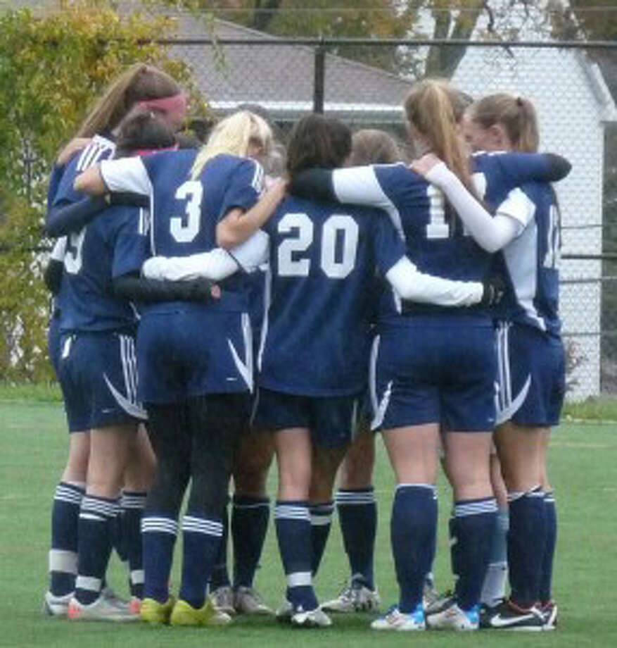 The Staples girls soccer team huddles before its 4-0 win at Stamford Thursday. Although the Lady Wreckers won 4-0 and finished the regular season at 8-5-3, they missed the FCIAC playoffs. Staples qualified for the Class LL playoffs and will begin its Class LL quest Nov. 7. Photo: Hunter Block / Contributed Photo