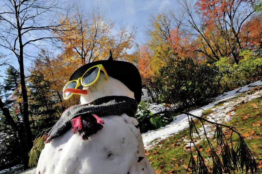 A snowman gets some midday sun on Sweetbrier Drive in Clifton Park, NY Frday, Oct. 28, 2011.( Michael P. Farrell/Times Union) Photo: Michael P. Farrell