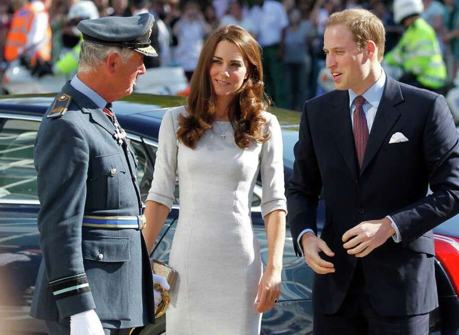 Prince William, Duke of Cambridge, right, and Kate, Duchess of Cambridge, center, are welcomed by the Queen's representative  Deputy Lieutenant Air Vice-Marshall Clive Evans, as they arrive at the Royal Mardsen hospital in Sutton, south London, Thursday, Sept. 29, 2011. The Duke and Duchess were at the hospital to open the new specialist children's cancer treatment ward, the Oak Centre for children and young people. Photo: Sang Tan, AP / AP