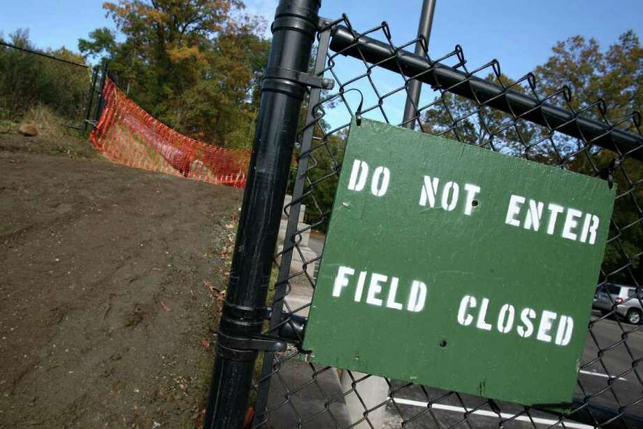 Four Greenwich High School athletic fields were still closed, as of Friday, Oct. 28, 2011, due to contaminated soil that was discovered over the summer when the school's new auditorium project broke ground.  Officials are still working on an environmental investigation and remediation program for the entire site. Photo: David Ames / Greenwich Time