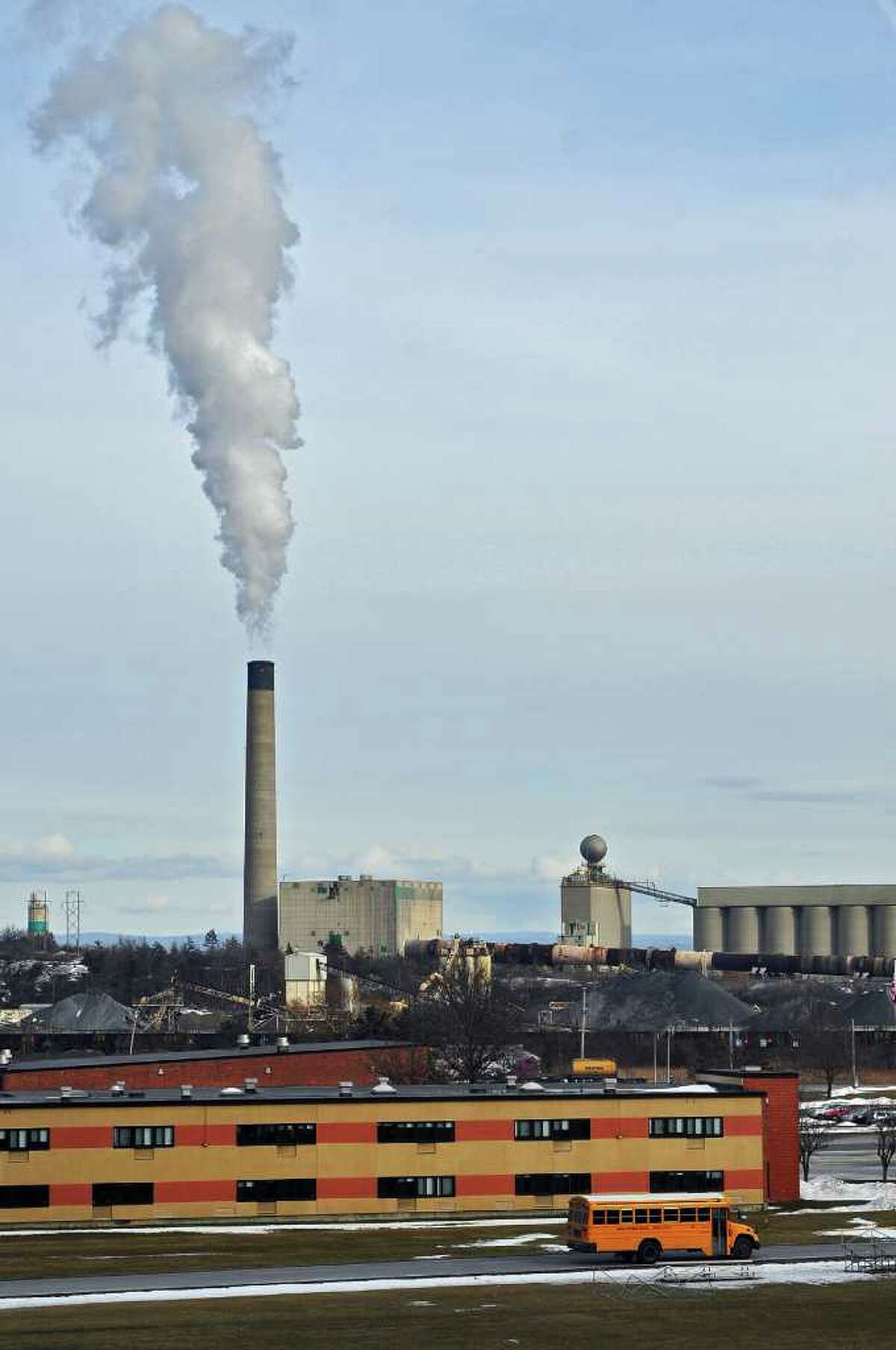 FILE - View of the Lafarge Cement Plant in Ravena, NY on Thursday January 6, 2011. The Ravena-Coeymans-Selkirk high school is in the foreground. ( Philip Kamrass / Times Union )