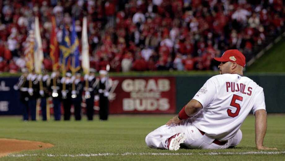 St. Louis Cardinals' Albert Pujols stretches before Game 7 of baseball's World Series against the Texas Rangers Friday, Oct. 28, 2011, in St. Louis. (AP Photo/Charlie Riedel) Photo: Charlie Riedel, Associated Press / AP