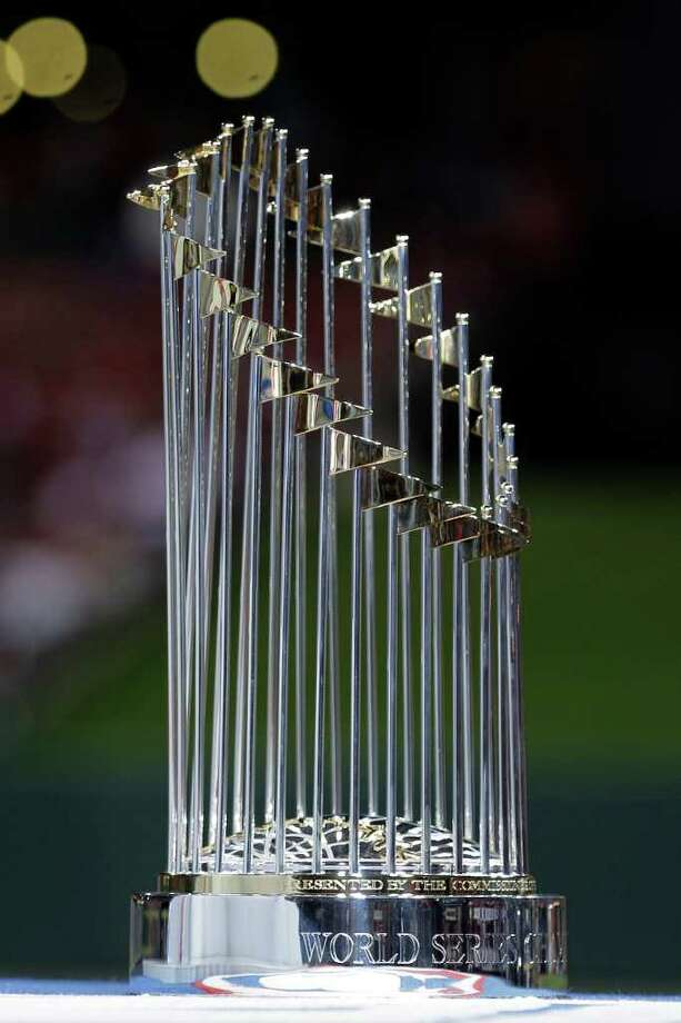 The World Series trophy is seen before Game 6 of baseball's World Series, Thursday, Oct. 27, 2011, in St. Louis. The St. Louis Cardinals face the Texas Rangers in Game 7 on Friday, Oct. 28, 2011. (AP Photo/Charlie Riedel) Photo: Charlie Riedel, Associated Press / AP2011