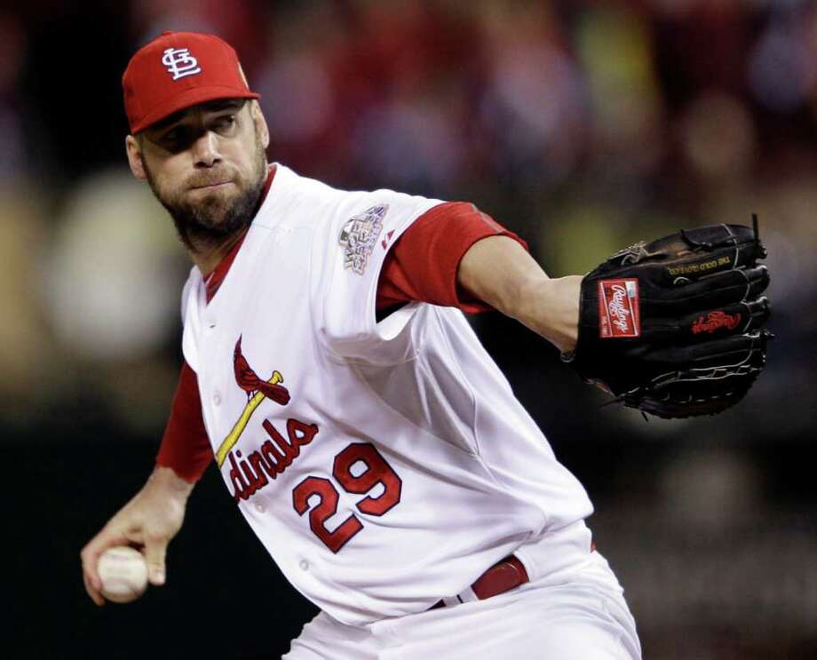 St. Louis Cardinals starting pitcher Chris Carpenter throws during the first inning of Game 7 of baseball's World Series against the Texas Rangers Friday, Oct. 28, 2011, in St. Louis. (AP Photo/Matt Slocum) Photo: Matt Slocum, Associated Press / AP